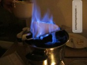 """Special type of mulled wine: """"Feuerzangenbowle"""". A sugar cone is watered with high-proof rum, burned and caramelized over a pot of dry red wine."""