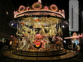 Illumination at it's best! - Vintage carousel at the Christmas market in Leipzig